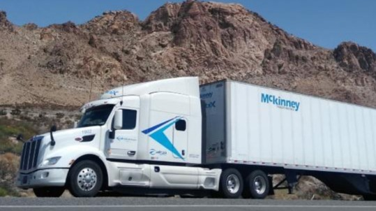 Mckinney trailer on the road with scenic mountain background