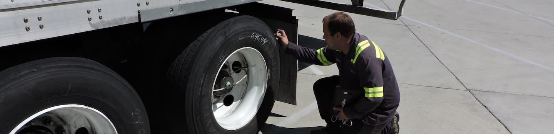 MCK-maintenance-technician-inspecting-trailer